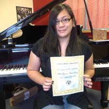 Marlynn Sanchez receiving the certificate level 2