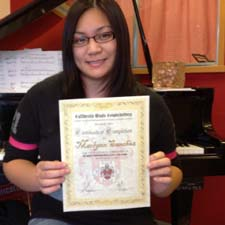 Marlynn Sanchez receiving the certificate level 3