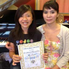 Vy Lam receiving the certificate level 2